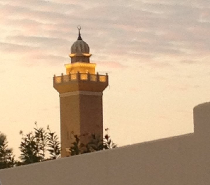 Beautifully lit mosque tower.