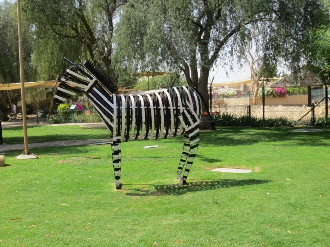 cute metal sculpture of a zebra