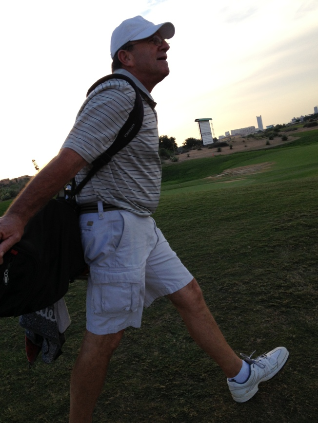 And yes, TBG, hauling his clubs.   Says something about good exercise..... I think he's too cheap to tip a caddy!